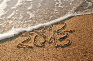 15506184-2012-and-new-year-2013-coming--waves-erase-year-2012-on-the-sandy-beach_large